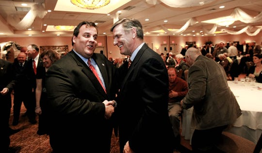Former U.S. Attorney Chris Christie (left) eagerly shakes the hand of George Gilmore as Christie arrives at the Toms River Holiday Inn to accept the Ocean County Republican Party's endorsement of his candidacy for governor on March 23, 2009.