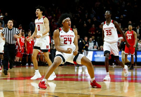 Jan 9, 2019; Piscataway, NJ, USA; Rutgers Scarlet Knights celebrate after defeating the Ohio State Buckeyes at Rutgers Athletic Center (RAC). Rutgers Scarlet Knights won 64-6.