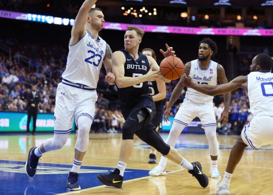 Butler Bulldogs guard Paul Jorgensen (5) drives to the basket as Seton Hall Pirates forward Sandro Mamukelashvili (23) defends