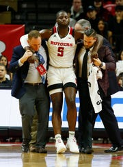 Jan 9, 2019; Piscataway, NJ, USA; Rutgers Scarlet Knights forward Eugene Omoruyi (5) is helped off of the court after suffering an apparent injury during the first half against the Ohio State Buckeyes at Rutgers Athletic Center (RAC).