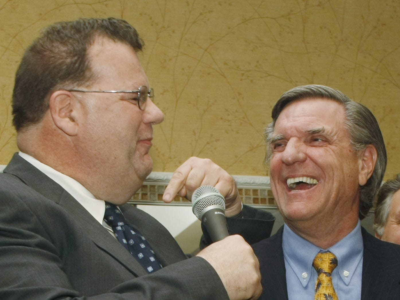 04/06/11- TOMS RIVER - Ocean County Freeholder John P. Kelly, left, makes a joke as he is introduced by Ocean County GOP chairman, George Gilmore, right. Ocean County Republican Party convenes at the Toms River Holiday Inn for its annual mini-convention to select candidates to run in the June 7 primary. They will be running for the vacant Assembly seat in the 10th Legislative District. Wednesday, April 6, 2011. Photo by Mary Frank/Staff Photographer - #88022.