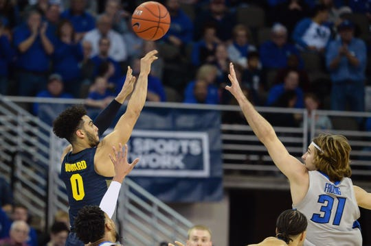Marquette Golden Eagles guard Markus Howard (0) shoots against the Creighton Bluejays