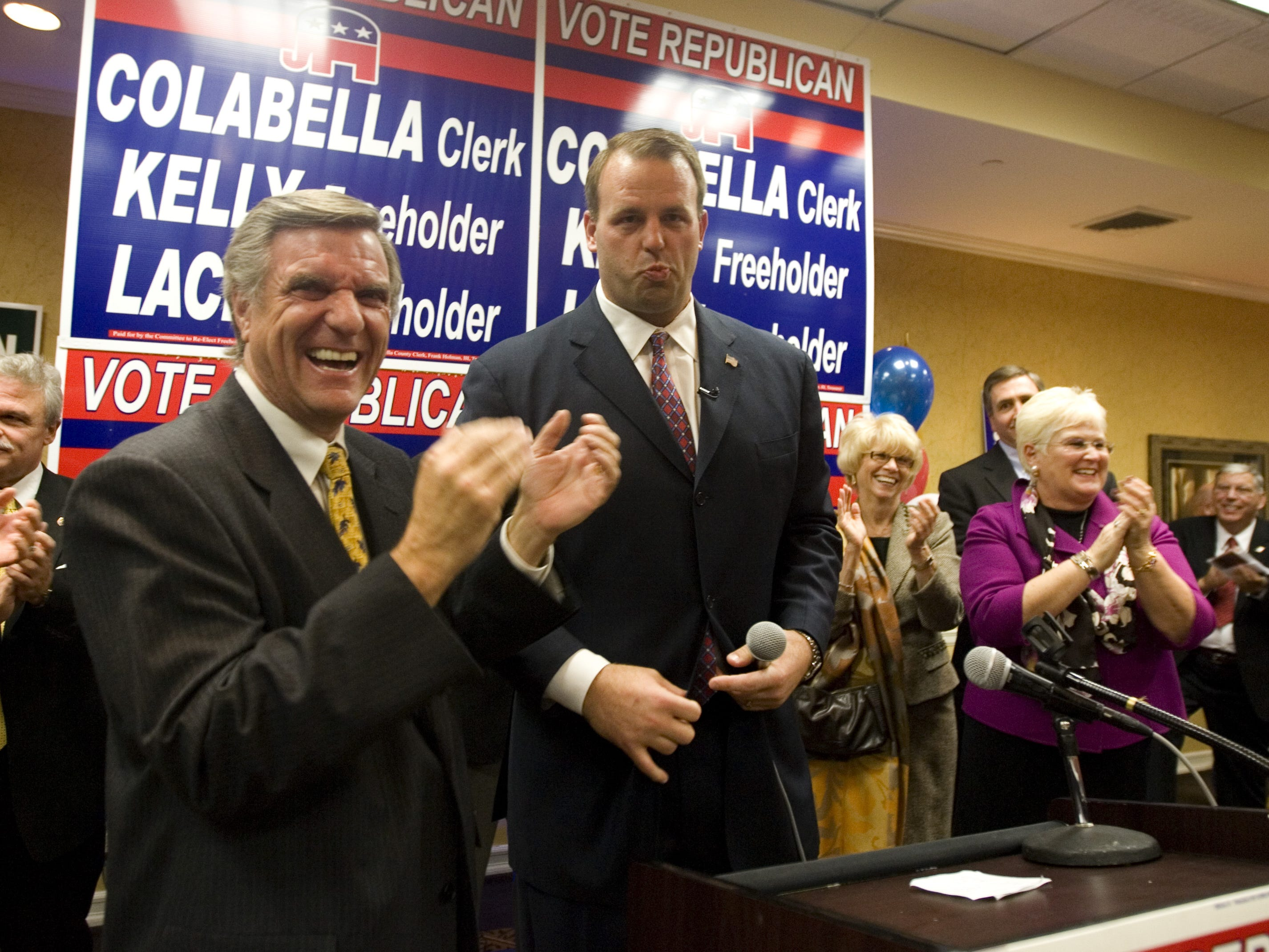 Republicans gather at the Holiday Inn in Toms River awaiting election results. George Gilmore, Ocean County GOP leader with Jon Runyan just after victory was announced.  Doug Hood/ Asbury Park Press- Toms River, NJ- 11.02.10 (#87496)