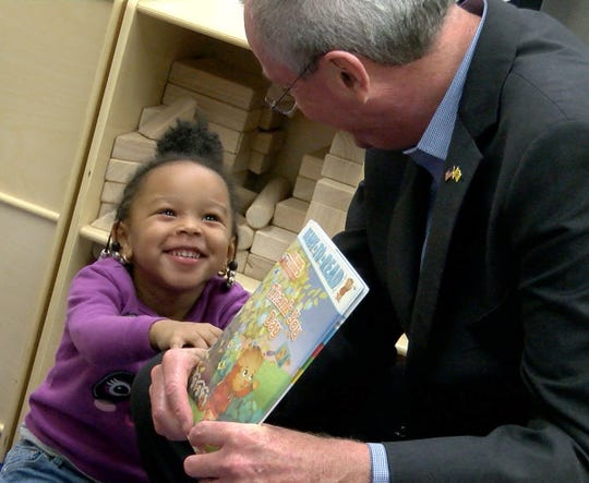 Woodmere Elementary School Pre-K student Mackenzie Brewington shares a smile with Governor Phil Murphy after he read a book in the classroom in Eatontown Thursday, January 10, 2019.