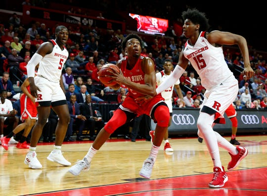 Jan 9, 2019; Piscataway, NJ, USA; Ohio State Buckeyes forward Andre Wesson (24) drives to the basket against Rutgers Scarlet Knights center Myles Johnson (15) during the first half at Rutgers Athletic Center (RAC).