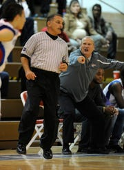 Referee Jeff Groban (left) gets an earful from Cooper coach Marc Case during a basketball game Dec. 10, 2013, at Cougar Gym.