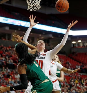 Texas Tech's Brittany Brewer (20) grabs a rebound after blocking a shot by Baylor's NaLyssa Smith (1) during the second half Sunday, Jan. 6, 2019, in Lubbock.