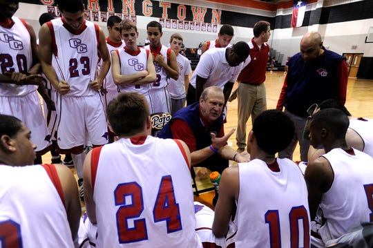 Former Cooper head coach Marc Case talks to his team during a timeout in Feb. 2011.