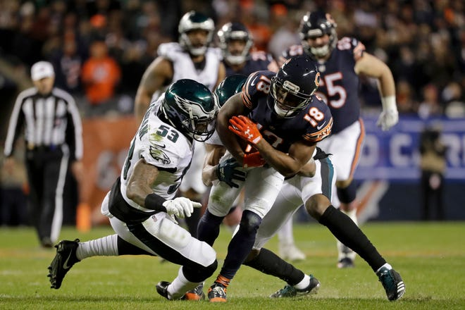 Chicago Bears wide receiver Taylor Gabriel (18) is tackled by Philadelphia Eagles outside linebacker Nigel Bradham (53) and cornerback Rasul Douglas, rear, during the first half of an NFL wild-card playoff game Sunday, Jan. 6, 2019, in Chicago.