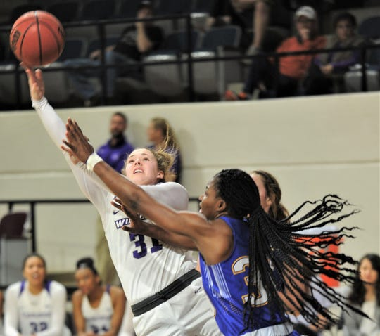 ACU's Madi Miller, left, shoots over a pair of McNeese defenders in the second half. The Wildcats beat McNeese 109-52 in the Southland Conference game Wednesday, Jan. 9, 2019, at Moody Coliseum.