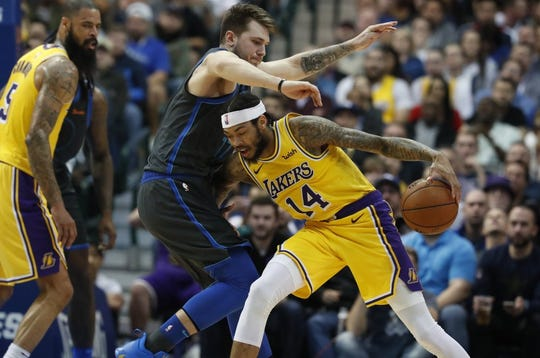 Los Angeles Lakers forward Brandon Ingram (14) drives against Dallas Mavericks forward Luka Doncic (77) of Germany during the second half of an NBA basketball game in Dallas on Monday.