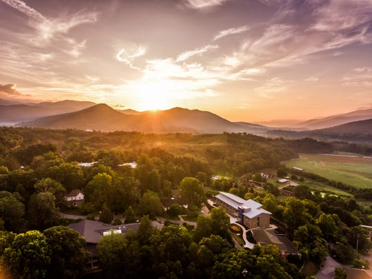 Sun sets over the Warren Wilson College campus in this drone photo of Myron Boon Hall, at lower right.