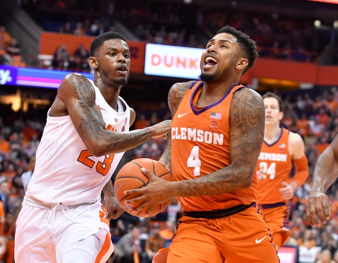 Jan 9, 2019; Syracuse, NY, USA; Clemson Tigers guard Shelton Mitchell (4) takes the ball to the basket as Syracuse Orange guard Frank Howard (23) defends in the first half at the Carrier Dome.