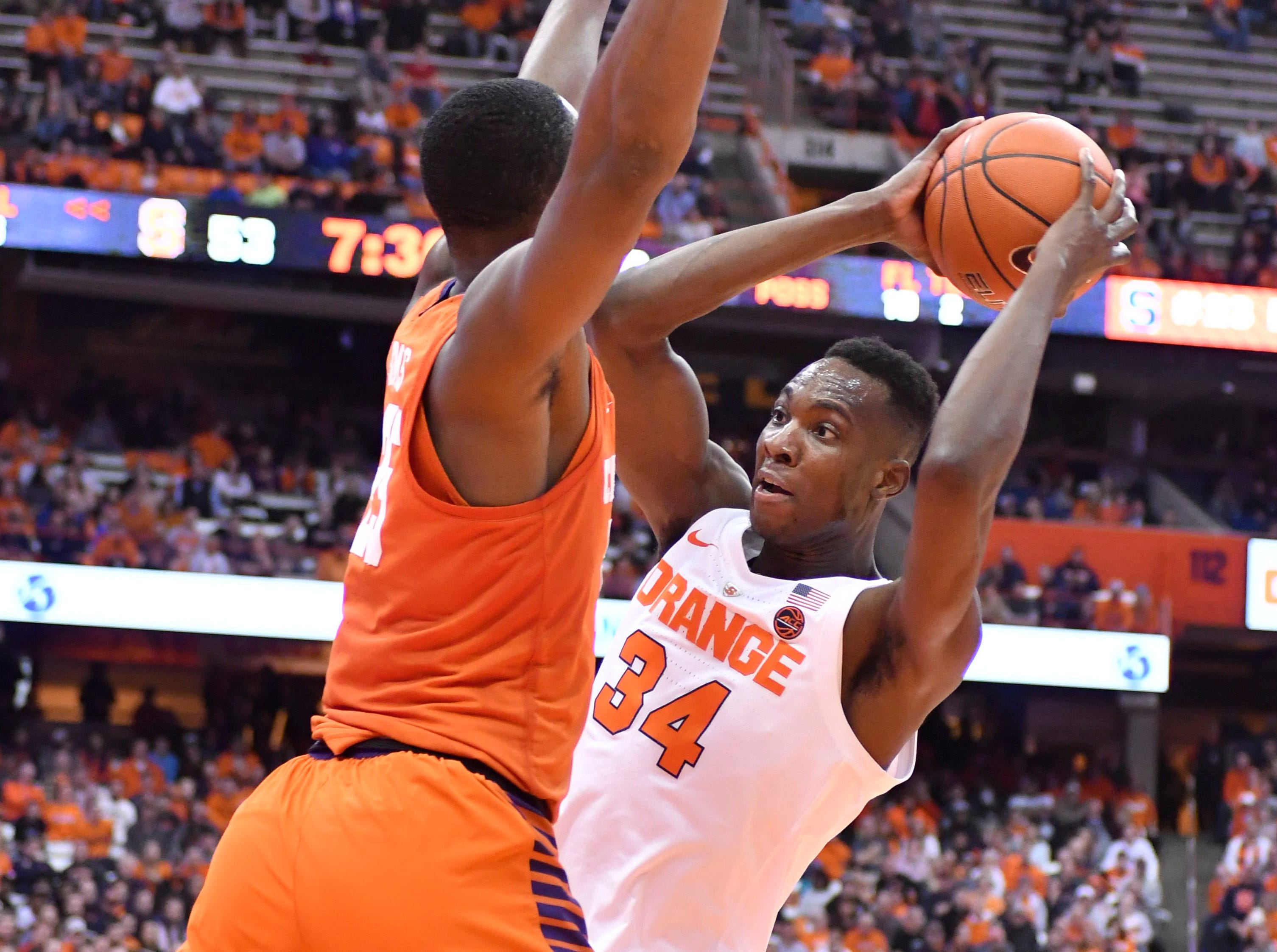 Jan 9, 2019; Syracuse, NY, USA; Syracuse Orange forward Bourama Sidibe (34) is pressured by Clemson Tigers forward Aamir Simms (25) in the second half at the Carrier Dome.