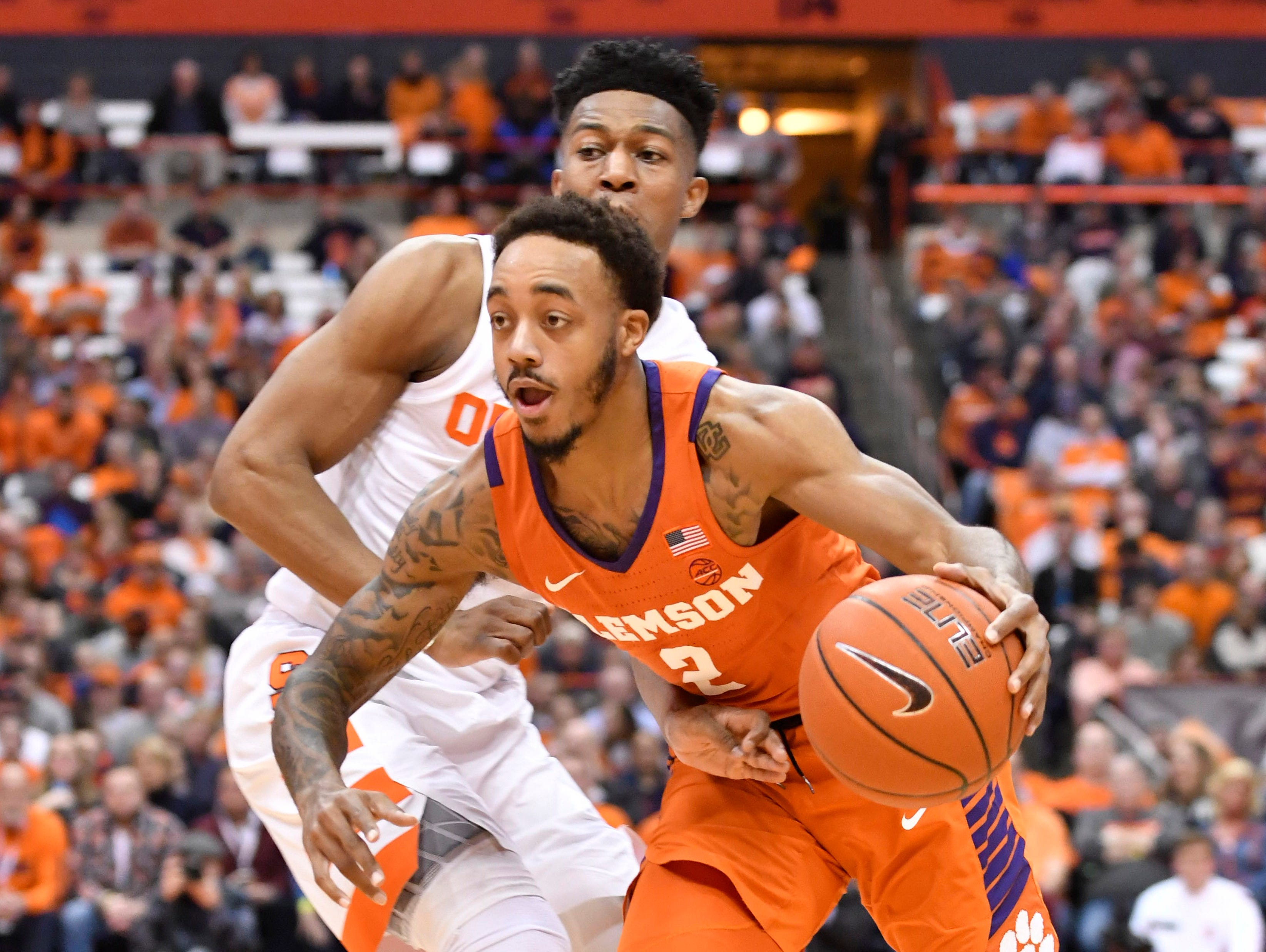 Jan 9, 2019; Syracuse, NY, USA; Clemson Tigers guard Marcquise Reed (2) drives the ball past Syracuse Orange guard Tyus Battle (25) during the first half at the Carrier Dome.