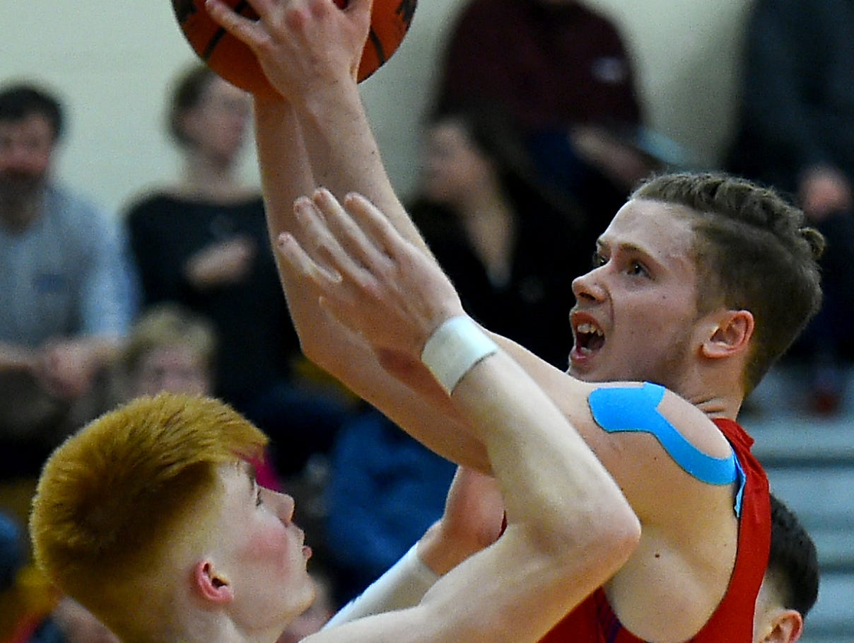 Owego's Christian Sage (1) looks to score past M-E's Gannon Russell (0) during Owego at Maine-Endwell boys basketball. Wednesday, January 9, 2018.