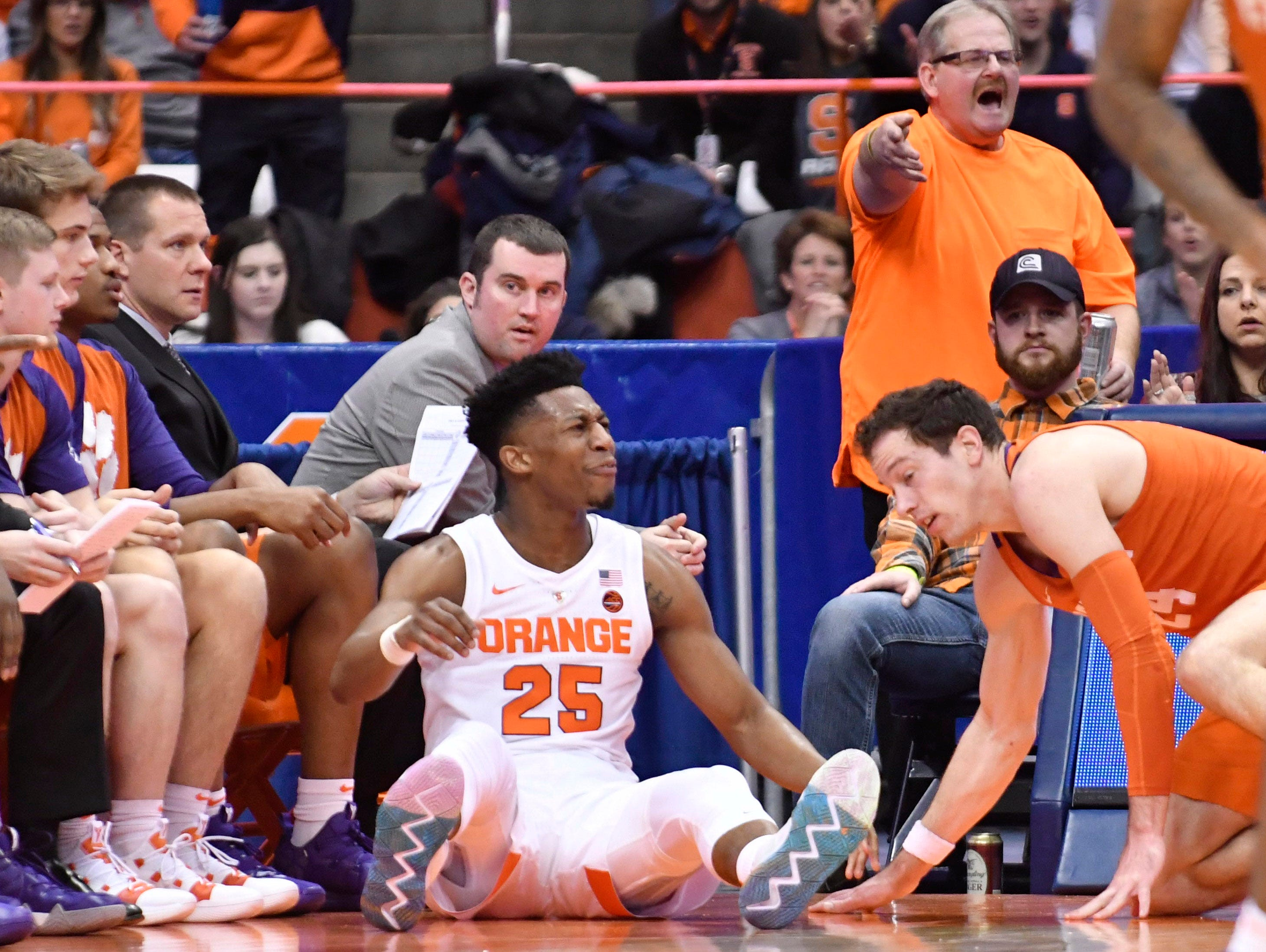 Jan 9, 2019; Syracuse, NY, USA; Syracuse Orange guard Tyus Battle (25) reacts to being knocked to the floor by Clemson Tigers forward David Skara (24) during the first half at the Carrier Dome.
