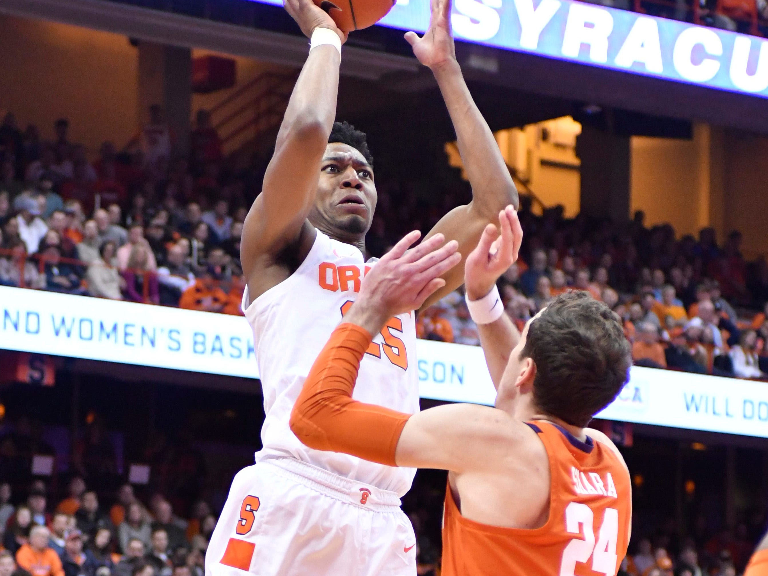 Jan 9, 2019; Syracuse, NY, USA; Syracuse Orange guard Tyus Battle (25) shoots a jump shot against Clemson Tigers forward David Skara (24) in the second half at the Carrier Dome.