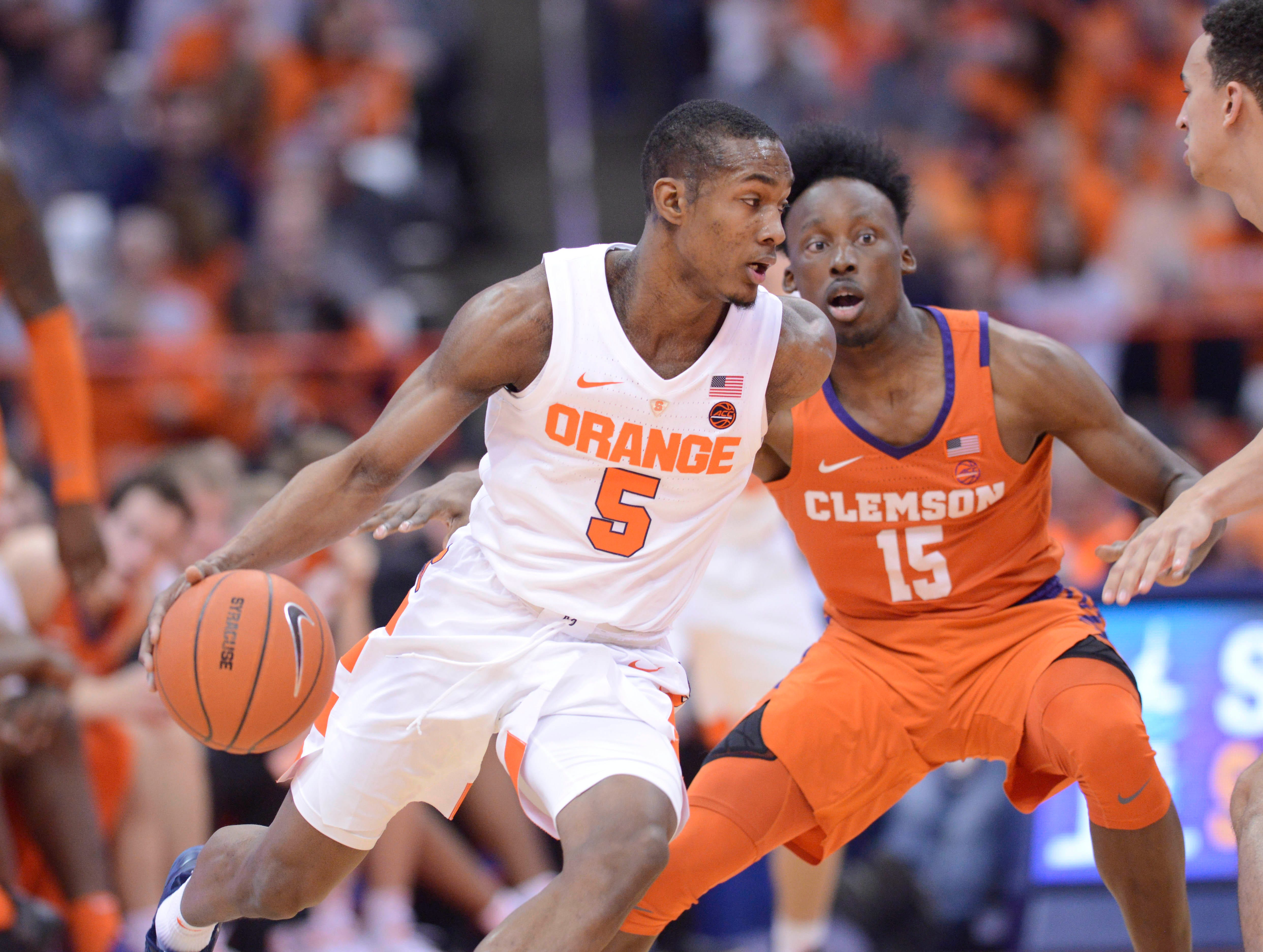 Jan 9, 2019; Syracuse, NY, USA; Syracuse Orange guard Jalen Carey (5) drives the ball against Clemson Tigers guard John Newman III (15) during the first half at the Carrier Dome.