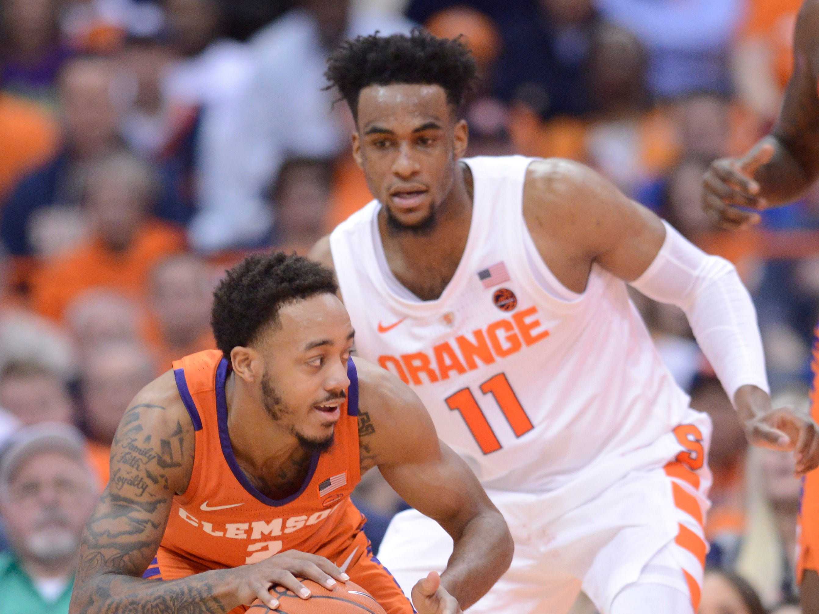 Jan 9, 2019; Syracuse, NY, USA; Clemson Tigers guard Marcquise Reed (2) protects the ball against Syracuse Orange forward Oshae Brissett (11) during the second half at the Carrier Dome.