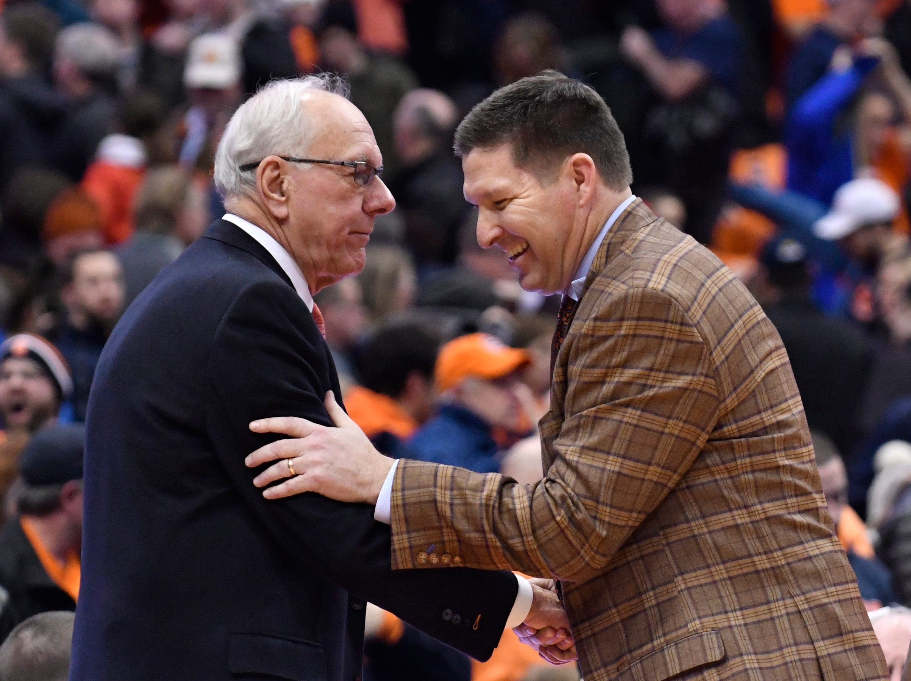 Jan 9, 2019; Syracuse, NY, USA; Syracuse Orange head coach Jim Boeheim is greeted by Clemson Tigers head coach Brad Brownell (right) after a game at the Carrier Dome.