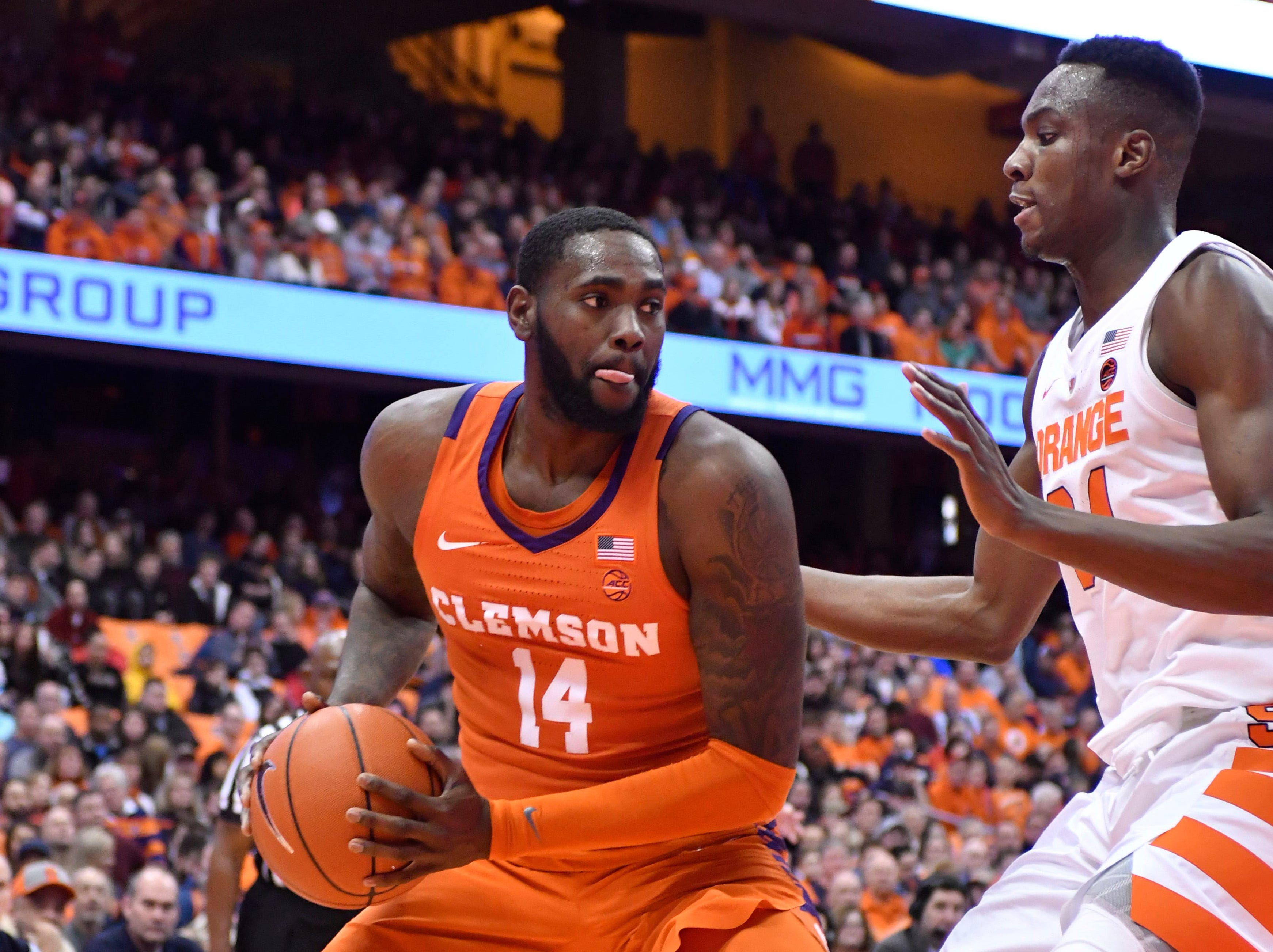 Jan 9, 2019; Syracuse, NY, USA; Clemson Tigers forward Elijah Thomas (14) posts up against Syracuse Orange forward Bourama Sidibe (34) in the first half at the Carrier Dome.