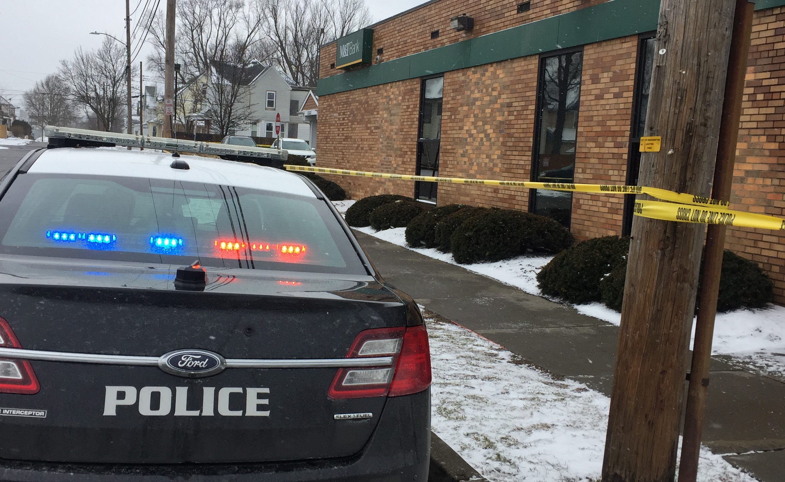 Binghamton police investigate a robbery at M&T Bank on Robinson Street.