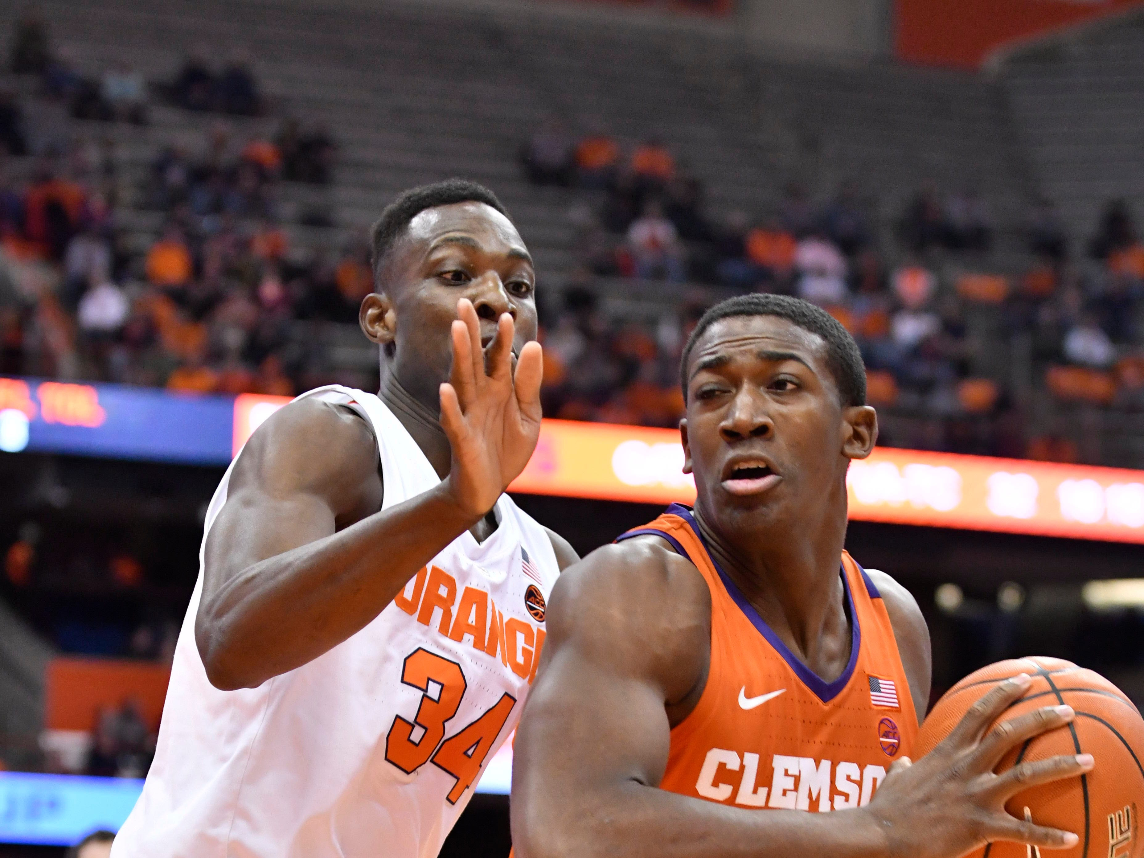 Jan 9, 2019; Syracuse, NY, USA; Clemson Tigers center Trey Jemison (55) turns to the basket against Syracuse Orange forward Bourama Sidibe (34) during the first half at the Carrier Dome.