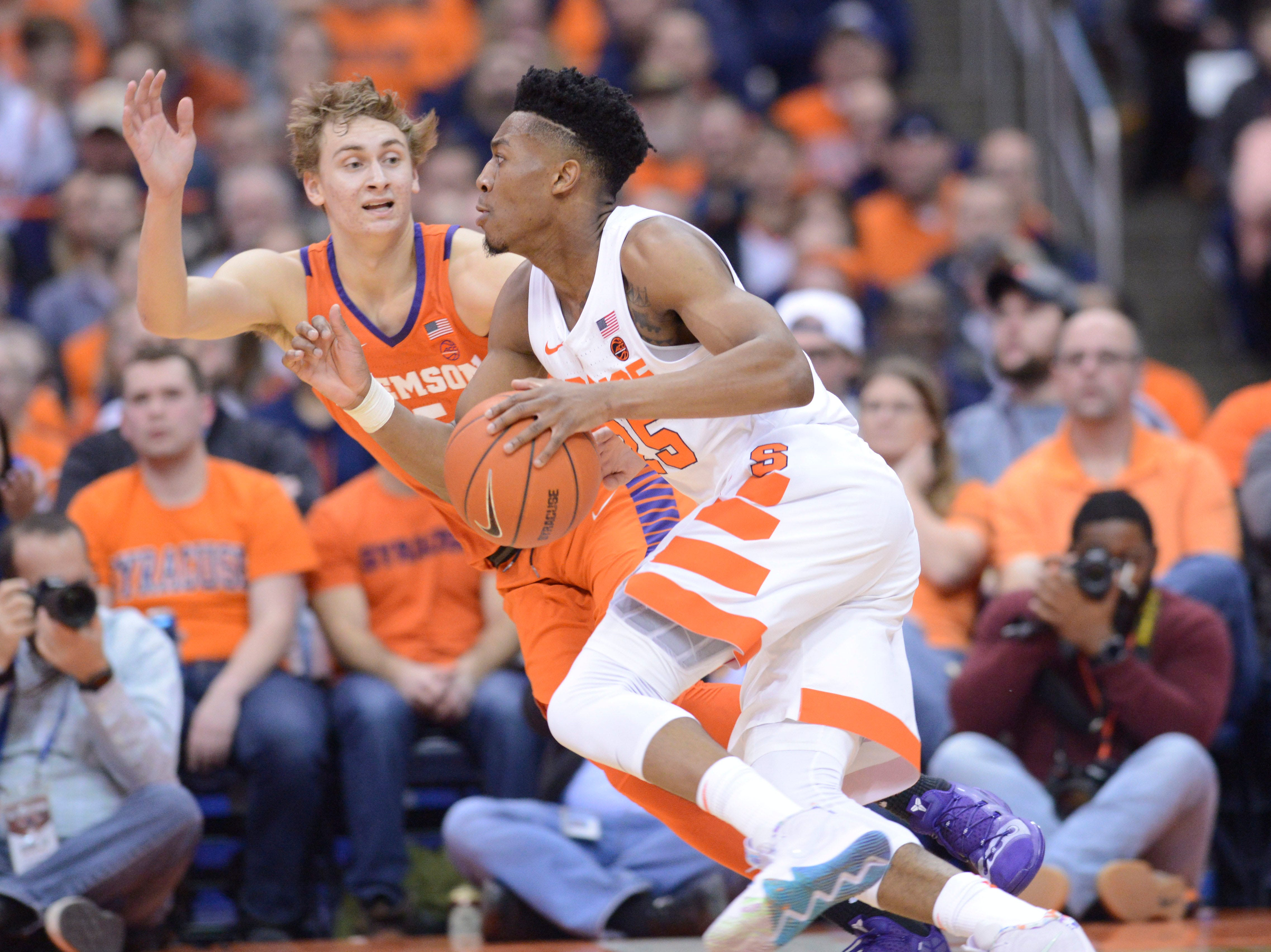 Jan 9, 2019; Syracuse, NY, USA; Syracuse Orange guard Tyus Battle (25) drives the ball against Clemson Tigers forward Hunter Tyson (5) during the first half at the Carrier Dome.