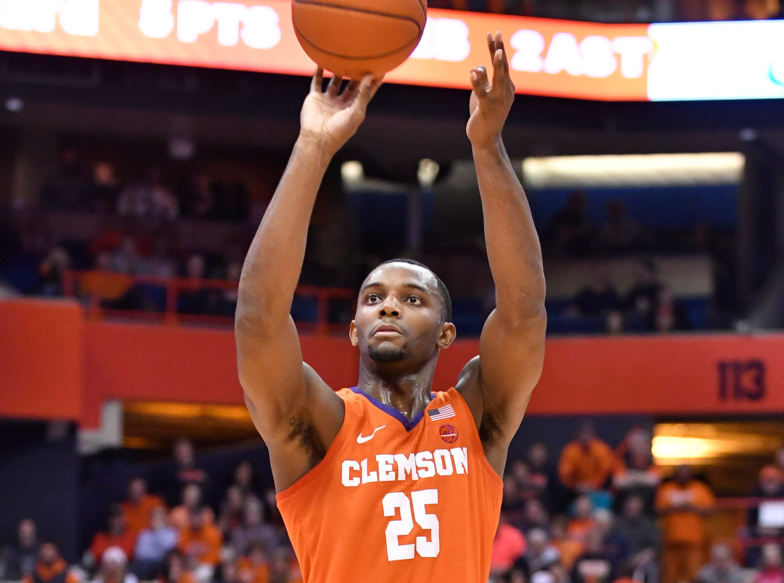 Jan 9, 2019; Syracuse, NY, USA; Clemson Tigers forward Aamir Simms (25) takes a jump shot during the first half against the Syracuse Orange at the Carrier Dome.