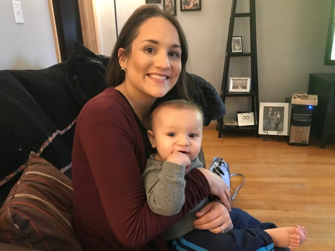 Mindi Prince and her son, Carson, in her Binghamton home.