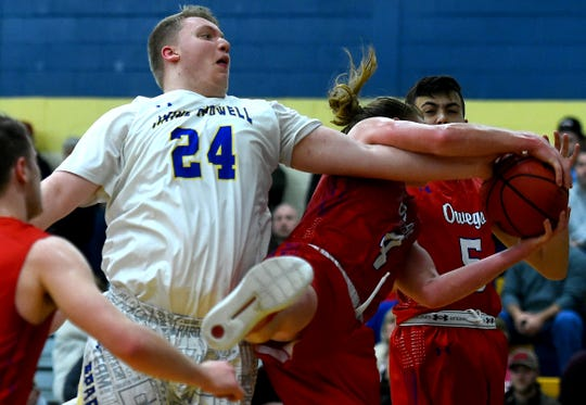 M-E's Chad VanPatten (24) looks to get the ball from Owego's Isaiah Bishop (4) first half of action. Owego at Maine-Endwell boys basketball. Wednesday, January 9, 2018.