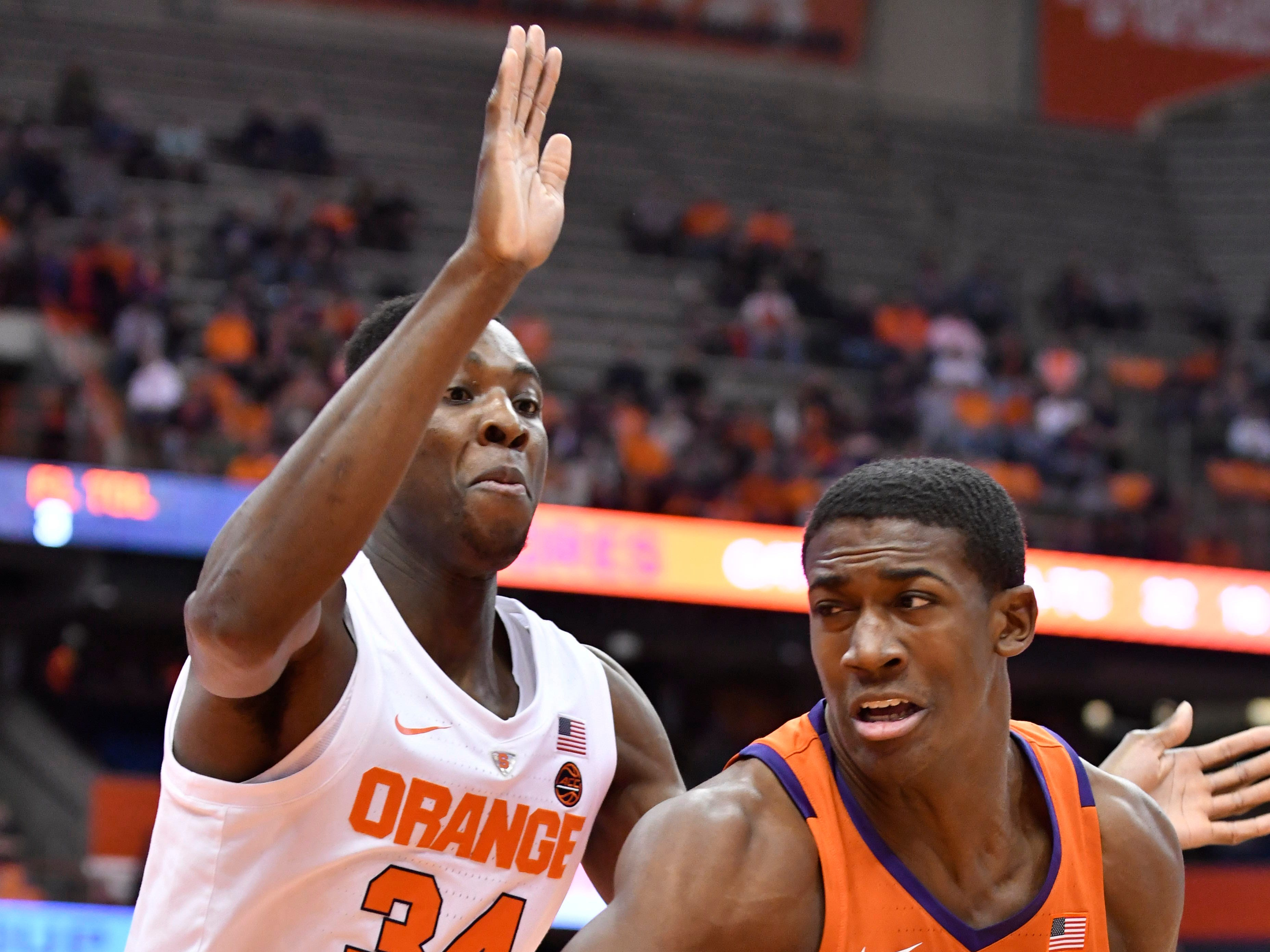 Jan 9, 2019; Syracuse, NY, USA; Clemson Tigers center Trey Jemison (55) turns to the basket as Syracuse Orange forward Bourama Sidibe (34) defends during the first half at the Carrier Dome.