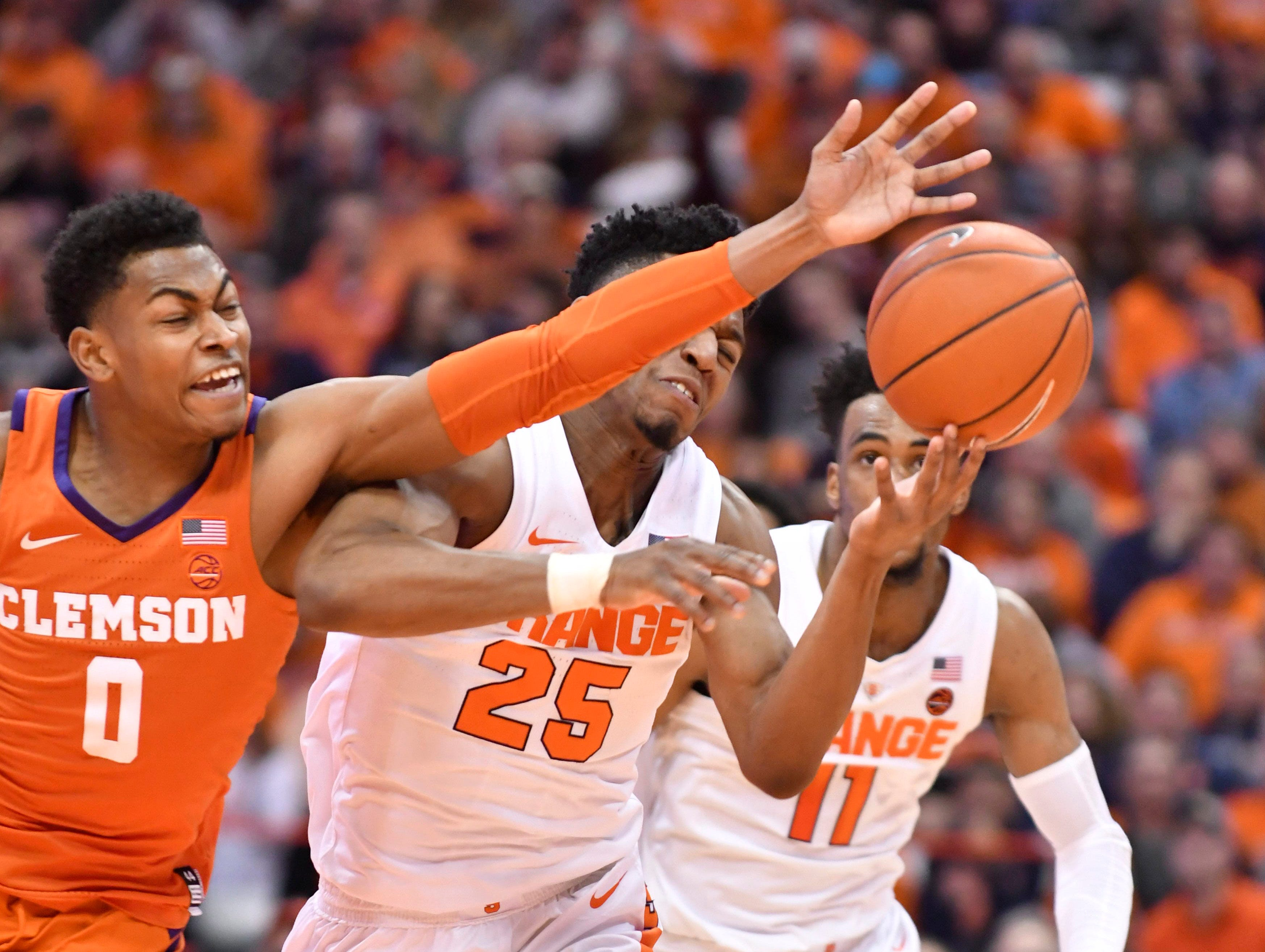 Jan 9, 2019; Syracuse, NY, USA; Clemson Tigers guard Clyde Trapp (0) fights for a loose ball with Syracuse Orange guard Tyus Battle (25) during the second half at the Carrier Dome.