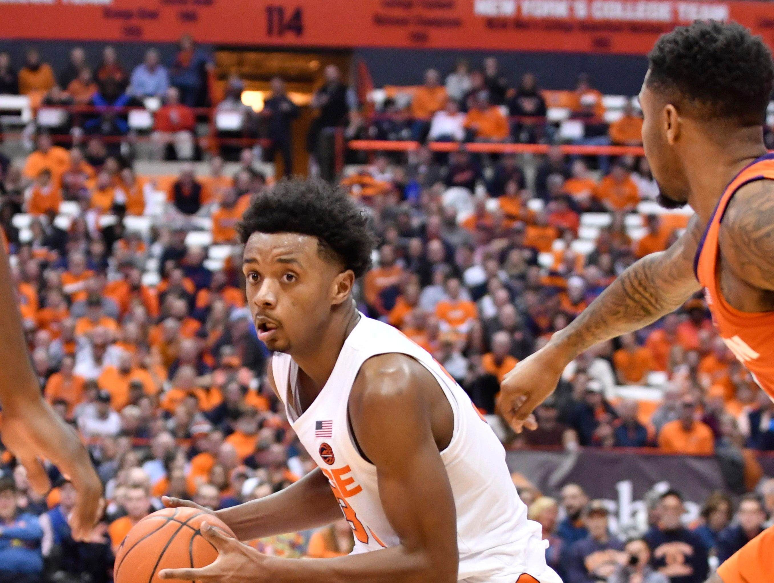 Jan 9, 2019; Syracuse, NY, USA; Syracuse Orange forward Elijah Hughes (33) changes direction on his dribble against the Clemson Tigers during the second half at the Carrier Dome.