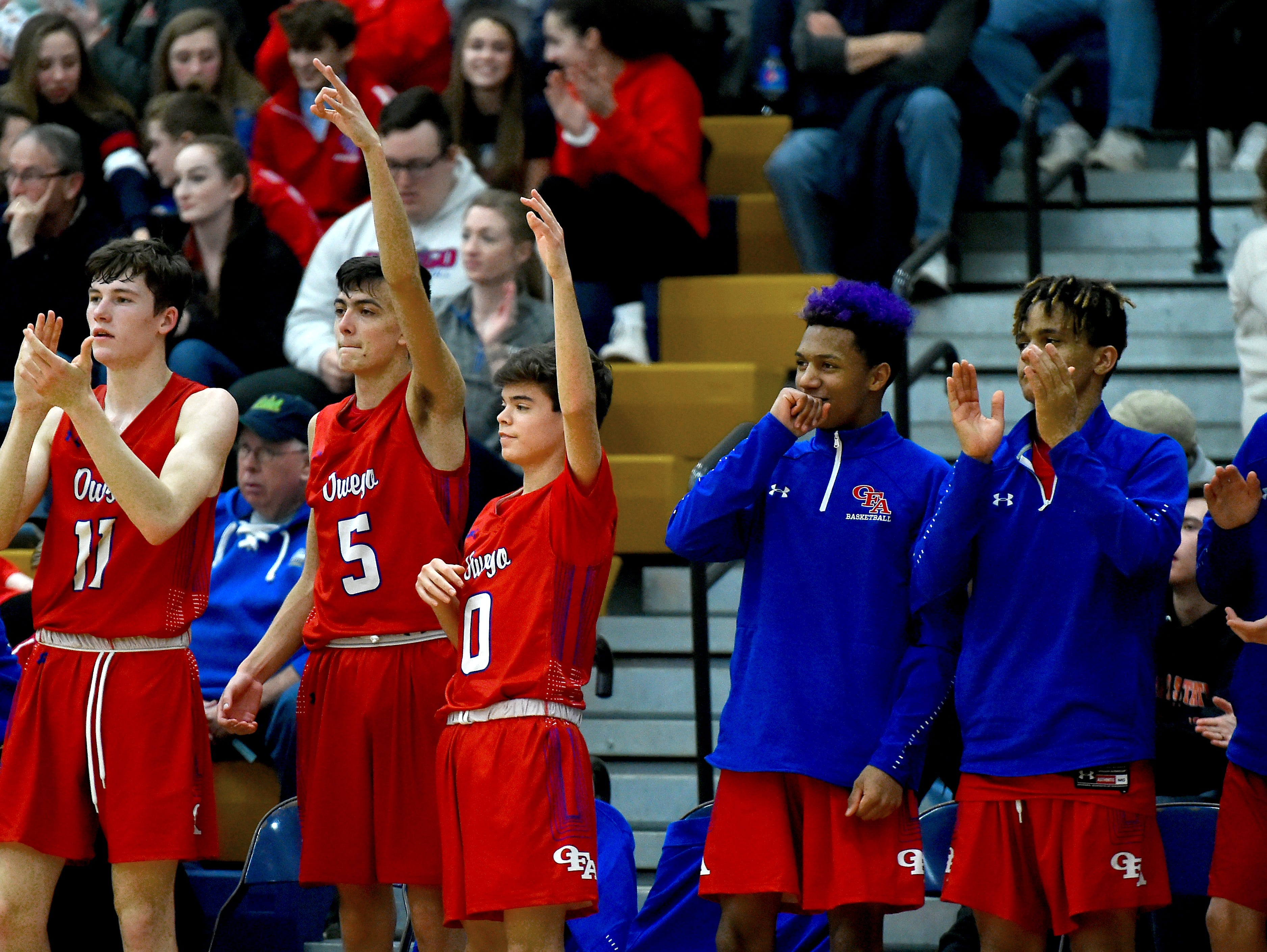 Owego teammates show support from the bench during Owego at Maine-Endwell boys basketball. Wednesday, January 9, 2018.