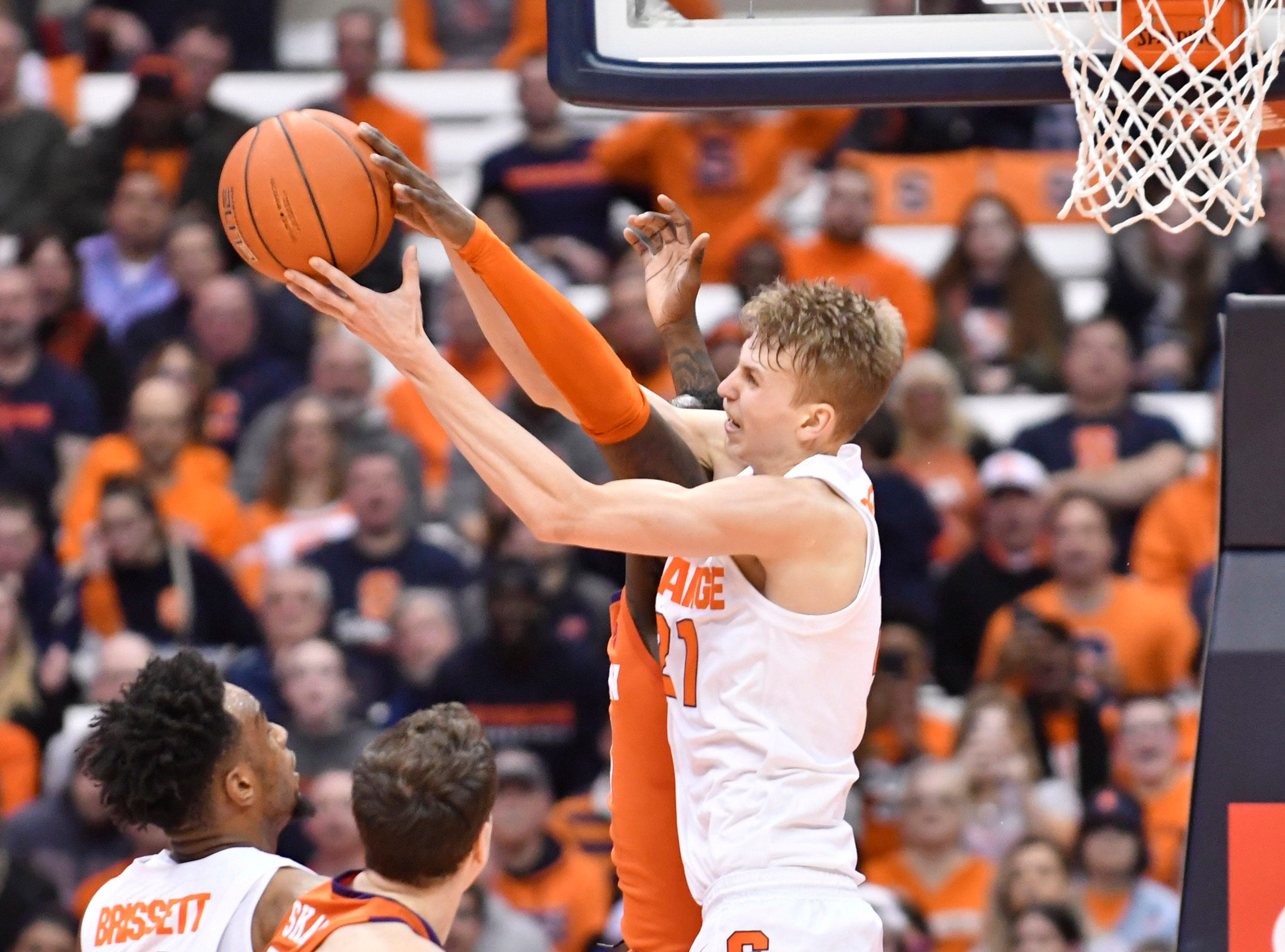 Jan 9, 2019; Syracuse, NY, USA; Syracuse Orange forward Marek Dolezaj (21) battles for a rebound during the first half against the Clemson Tigers at the Carrier Dome.