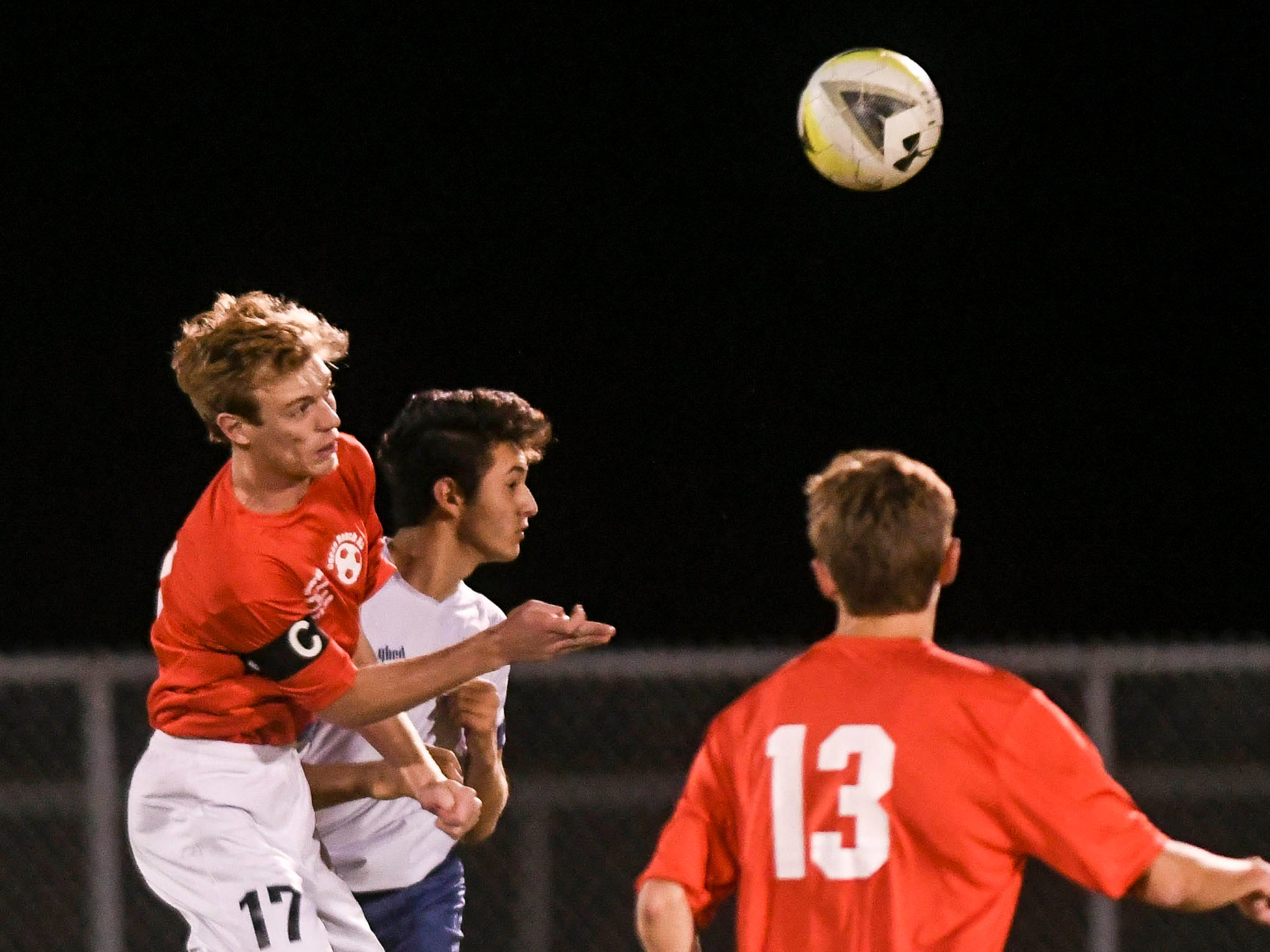 David Mundy of Cocoa Beach and Robbie DuJovne of West Shore try to head the ball during Wednesday's game in Cocoa Beach