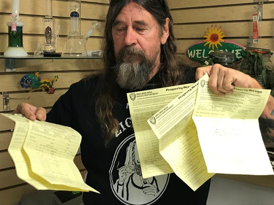 "Larry Friedrich found himself in a ""hemp"" of trouble with Melbourne Police for selling a low-grade hemp product at his shop at the Renniger Flea Market in Melbourne. Here is holding yellow receipts of the products seized by police."