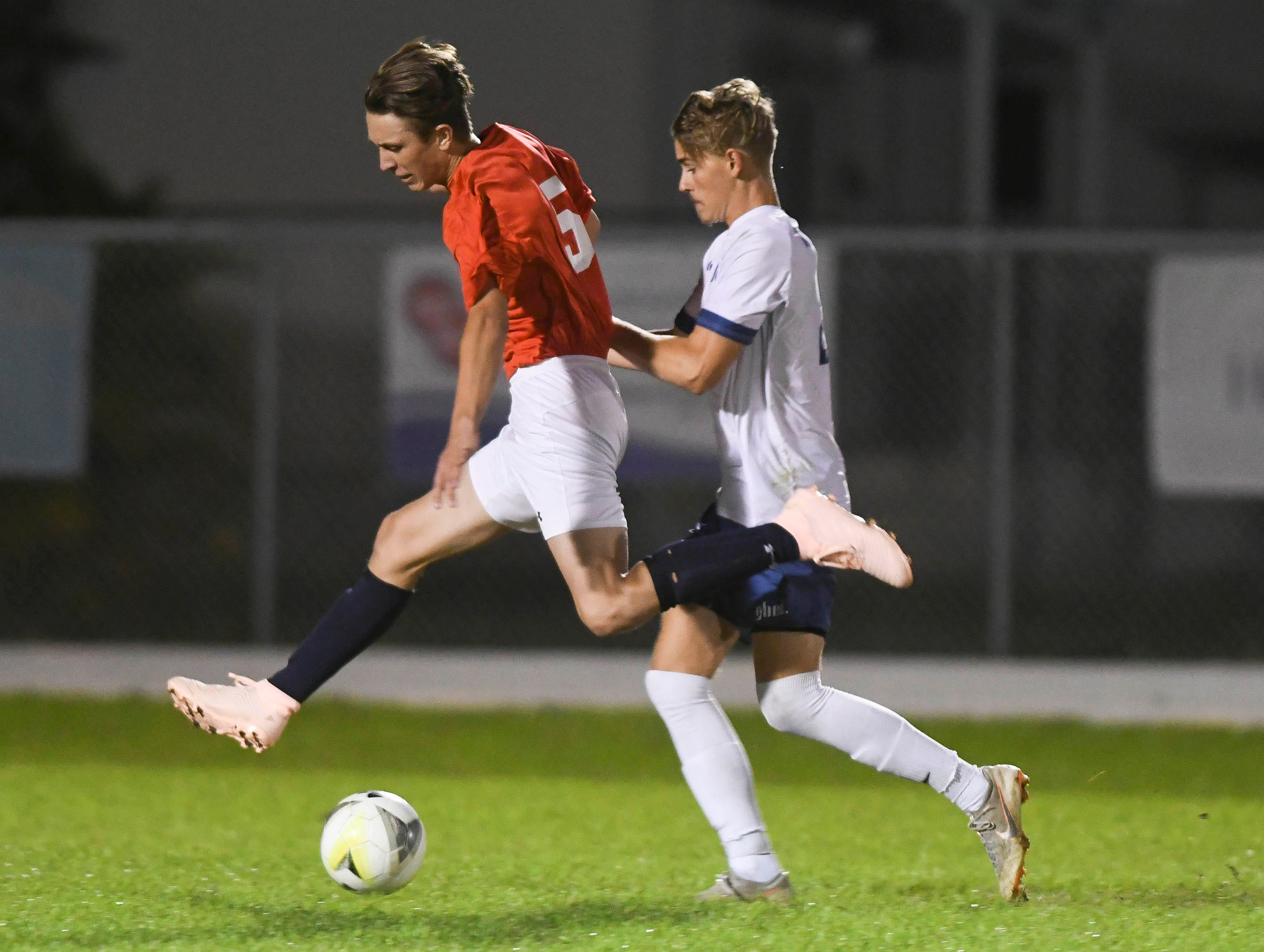 Cocoa Beach's Eric Anderson (5) and Ian Leighton of West Shore battle for the ball during Wednesday's game in Cocoa Beach