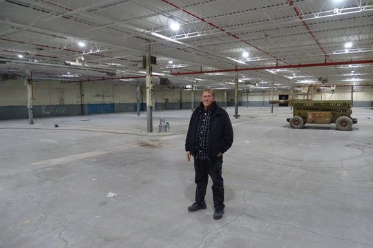 Danny Burns, site manager of Ohio Polytech, the former Swan plant, stands in an area of the building the company is renovating.
