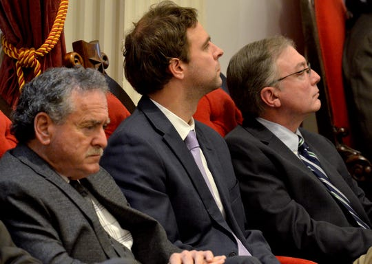 Three of Chittenden County's state senators, from left, Michael Sirotkin, Tim Ashe and Phil Baruth, listen to Gov. Phil Scott's inaugural address Jan. 10, 2019.
