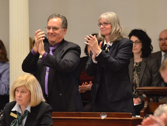 Vermont House Minority Leader Rep. Patricia McCoy, R-Rutland, right, and Assistant Minority Leader Rep. Rob LaClair, R-Barre Town, stand to applaud a line in Gov. Phil Scott's inaugural address on Jan. 10, 2019.