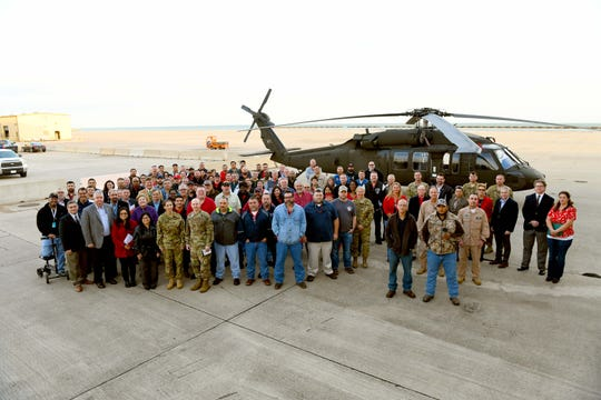 CCAD leaders, employees and visitors pose for a photo in front of a UH-60L (Lima model) Black Hawk helicopter immediately following the CCAD UH-60V Induction Ceremony, here, January 9, 2019. The Black Hawk shown will be the first one scheduled for induction into the UH-60V (Victor model) project, which is a modification of the UH-60L to UH-60V providing a new digital, glass cockpit configuration to the Black Hawk's current analog dial instrumentation. The depot is scheduled to produce more than 700 Victor models in the next decade.