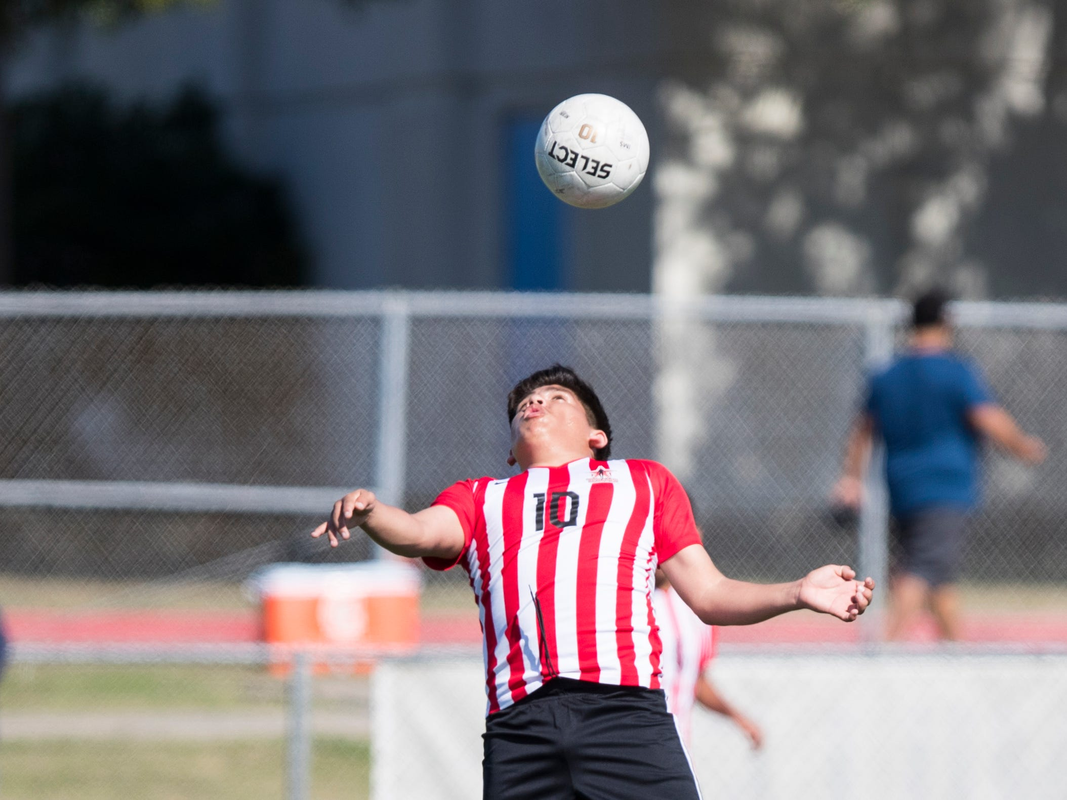 Ray's Yahir Villanueva hits the ball off his head during the game against Kingsville in the Mira's Soccer Tournament at Cabaniss Field on Thursday, January 10, 2019. Ray won the game 2-0.