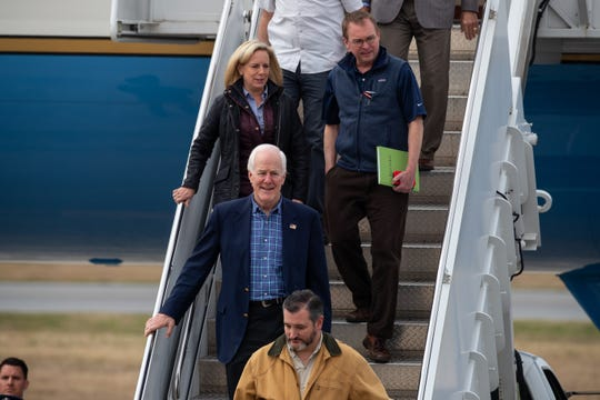 Sen. Ted Cruz R-TX, Sen. John Cornyn R-TX and Homeland Secretary Kirstjen Nielsen arrive in McAllen, Texas, with President Donald Trump to discuss security along the U.S Southern border on Thursday, Jan. 10, 2019.