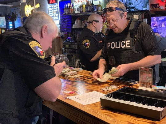 Aransas Pass police officers conducted a search a warrant at a bar on South Commercial Street on Thursday, Jan. 10, 2019. Police arrested the bar owner on suspicion of the illegal gambling operation.