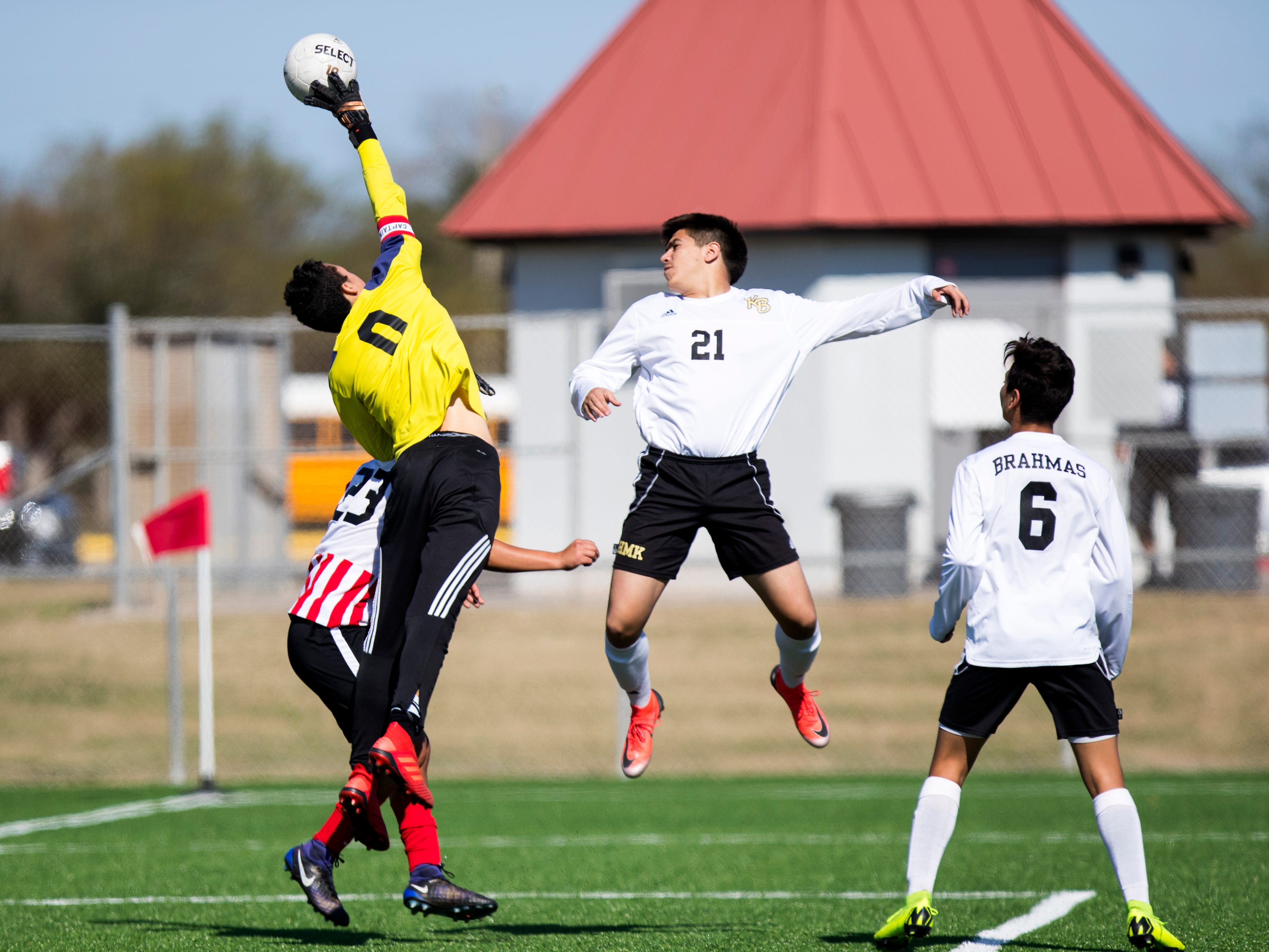 Kingsville's goalie blocks the ball as Kingsville's Oscar Ayarzagoitia jumps up (21) to deflect the ball in the Mira's Soccer Tournament at Cabaniss Field on Thursday, January 10, 2019. Ray won the game 2-0.