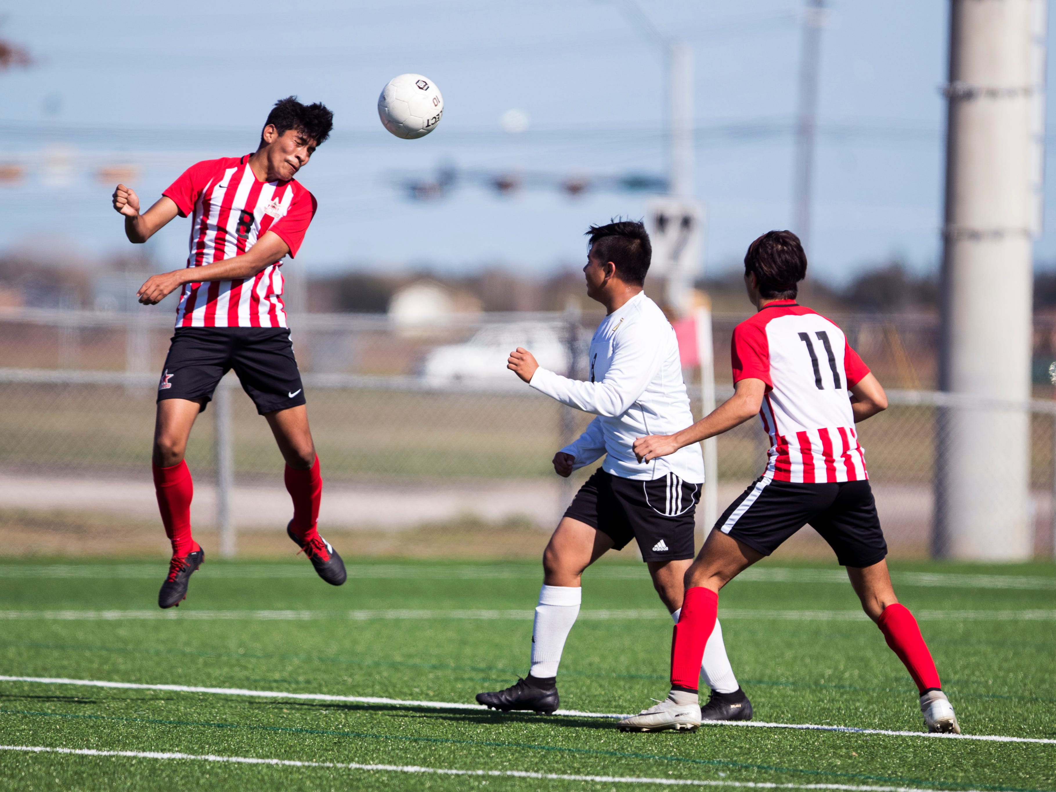 Ray's Jose Rodriguez hits the ball off his head in the game against Kingsville in the Mira's Soccer Tournament at Cabaniss Field on Thursday, January 10, 2019. Ray won the game 2-0.