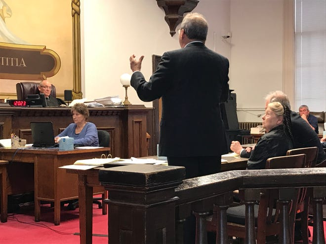 Fredericka Wagner looks up at her attorney James Owen as he argues on her behalf before Pike County Common Pleas Judge Randy Deering during a motion and pretrial hearing on Thursday, Jan. 10, 2019.